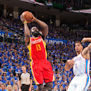 OKLAHOMA CITY, OK - MAY 1: James Harden #13 of the Houston Rockets shoots in the lane against Thabo Sefolosha #2 of the Oklahoma City Thunder in Game Five of the Western Conference Quarterfinals during the 2013 NBA Playoffs on May 1, 2013 at the Chesapeake Energy Arena in Oklahoma City, Oklahoma. (Photo by Layne Murdoch Jr./NBAE via Getty Images)