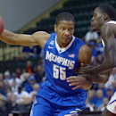 Memphis guard Geron Johnson (55) drives past LSU forward Shavon Coleman, right, during the first half of an NCAA college basketball game at the Old Spice Classic tournament in Kissimmee, Fla., Friday, Nov. 29, 2013.(AP Photo/Phelan M. Ebenhack)