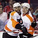 Philadelphia Flyers' Jason Akeson, right, celebrates with teammate Pierre-Edouard Bellemare (78) after scoring a goal against Washington Capitals goalkeeper Justin Peters during the second period of a NHL preseason hockey game, Thursday, Oct. 2, 2014, in