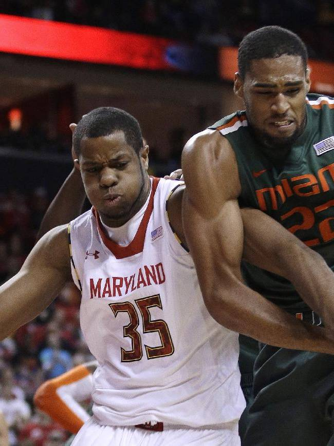 Maryland forward Damonte Dodd, left, and Miami forward Donnavan Kirk struggle for possession of a rebound during the second half of an NCAA college basketball game in College Park, Md., Wednesday, Jan. 29, 2014. Maryland won 74-71