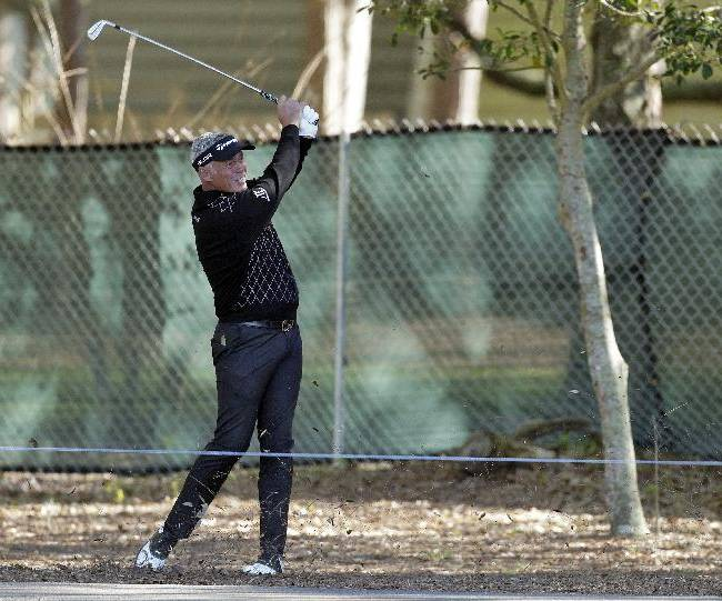 Darren Clarke, of Northern Ireland, hits from off the fairway on the 12th hole during the first round of the Valspar Championship golf tournament at Innisbrook, Thursday, March 13, 2014, in Palm Harbor, Fla