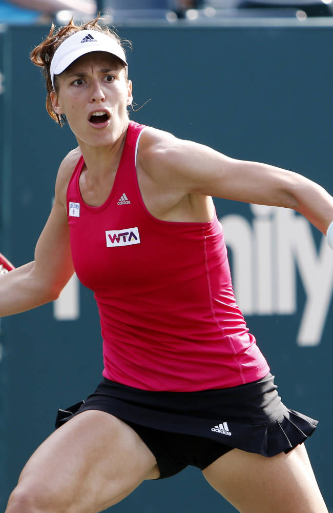 Andrea Petkovic, of Germany, returns to Sabine Lisicki, of Germany, during the Family Circle Cup tennis tournament in Charleston, S.C., Thursday, April 3, 2014