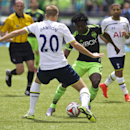 Seattle Sounders' Obafemi Martins (9) tries to get past Tottenham Hotspur's Michael Dawson during the first half of a friendly soccer match in Seattle, Saturday, July 19, 2014