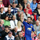 Manchester United's Juan Mata celebrates his goal during their English Premier League soccer match against Sunderland at the Stadium of Light, Sunderland, England, Sunday, Aug. 24, 2014