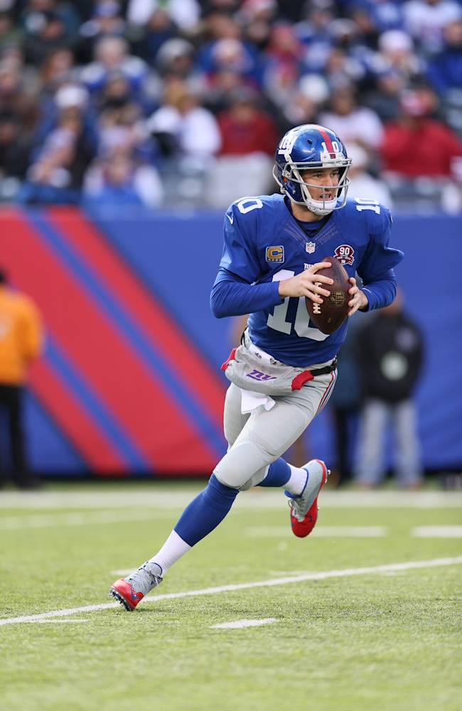 OUT OF CAMERA FILE - Eli Manning  (10) of the New York Giants in action against the Washington Redskins  on Sunday December 14, 2014 at MetLife Stadium in East Rutherford, NJ  (Damian Strohmeyer/ AP Images for DirecTV)