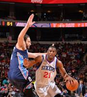 PHILADELPHIA, PA - JANUARY 15: Thaddeus Young #21 of the Philadelphia 76ers drives to the basket against the Charlotte Bobcats at the Wells Fargo Center on January 15, 2014 in Philadelphia, Pennsylvania. (Photo by Jesse D. Garrabrant/NBAE via Getty Images)