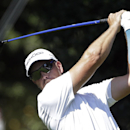 Henrik Stenson, of Sweden, hits from the fairway on the fourth hole during the first round of play in the PGA Tour Championship golf tournament at East Lake Golf Club in Atlanta, Thursday, Sept. 19, 2013. (AP Photo/John Bazemore)
