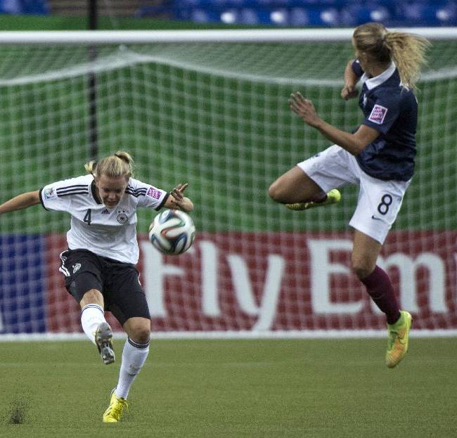 Germany's Margarita Gidion kicks the ball away from France's Sandie Toletti during first half FIFA U20 Women's World Cup semifinal soccer action Wednesday, Aug. 20, 2014, in Montreal