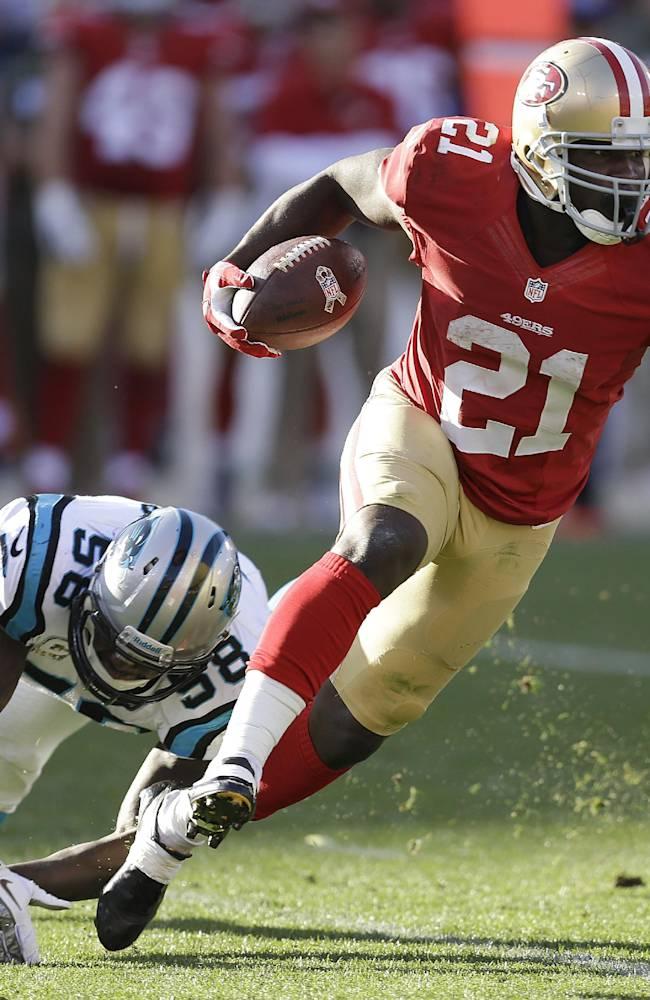 San Francisco 49ers running back Frank Gore (21) runs past Carolina Panthers outside linebacker Thomas Davis (58) during the second half of an NFL football game in San Francisco, Sunday, Nov. 10, 2013