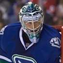 Vancouver Canucks goalie Ryan Miller watches the play during the first period of an NHL hockey game, Thursday, Oct. 30, 2014 in Vancouver, British Columbia The Associated Press