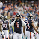 Chicago Bears quarterback Jay Cutler (6) adjusts his helmet after getting tackled during the second half of an NFL football game against the Miami Dolphins Sunday, Oct. 19, 2014 in Chicago. (AP Photo/Nam Y. Huh)
