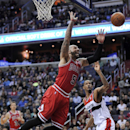 Chicago Bulls forward Carlos Boozer (5) loses the ball after he was fouled by Washington Wizards forward Trevor Ariza (1) during the first half of an NBA basketball game, Saturday, April 5, 2014, in Washington The Associated Press