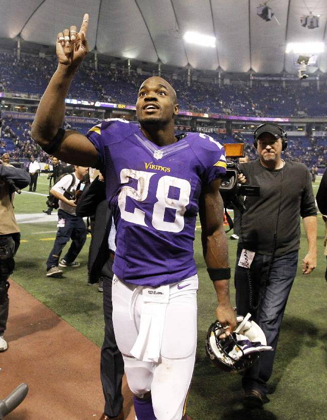 Minnesota Vikings running back Adrian Peterson reacts as he walks off the field after an NFL football game against the Washington Redskins, Thursday, Nov. 7, 2013, in Minneapolis. The Vikings won 34-27