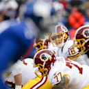 Washington Redskins quarterback Colt McCoy (16) waits for the snap at the line of scrimmage during the first quarter of an NFL football game against the New York Giants, Sunday, Dec. 14, 2014, in East Rutherford, N.J The Associated Press