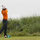 Rickie Fowler of the US plays a shot off the 13th tee during the final round of the British Open Golf championship at the Royal Liverpool golf club, Hoylake, England, Sunday July 20, 2014