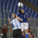 Argentina's Gonzalo Higuain, left, and Italy's Christian Maggio jump for the ball during a friendly soccer match between Italy and Argentina, at Rome's Olympic stadium, Wednesday, Aug.14, 2013. (AP Photo/Andrew Medichini)