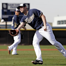 San Diego Padres pitcher Eric Stults fields a ground ball during spring training baseball practice Sunday, Feb. 16, 2014, in Peoria, Ariz The Associated Press