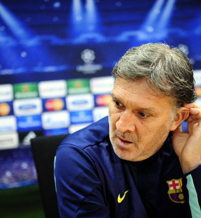 FC Barcelona's coach Gerardo Tata Martino, from Argentina, attends a press conference at the Sports Center FC Barcelona Joan Gamper in San Joan Despi, Spain, Tuesday, Dec. 10, 2013. FC Barcelona will play against Celtic in a group H Champions League next Wednesday Dec. 11