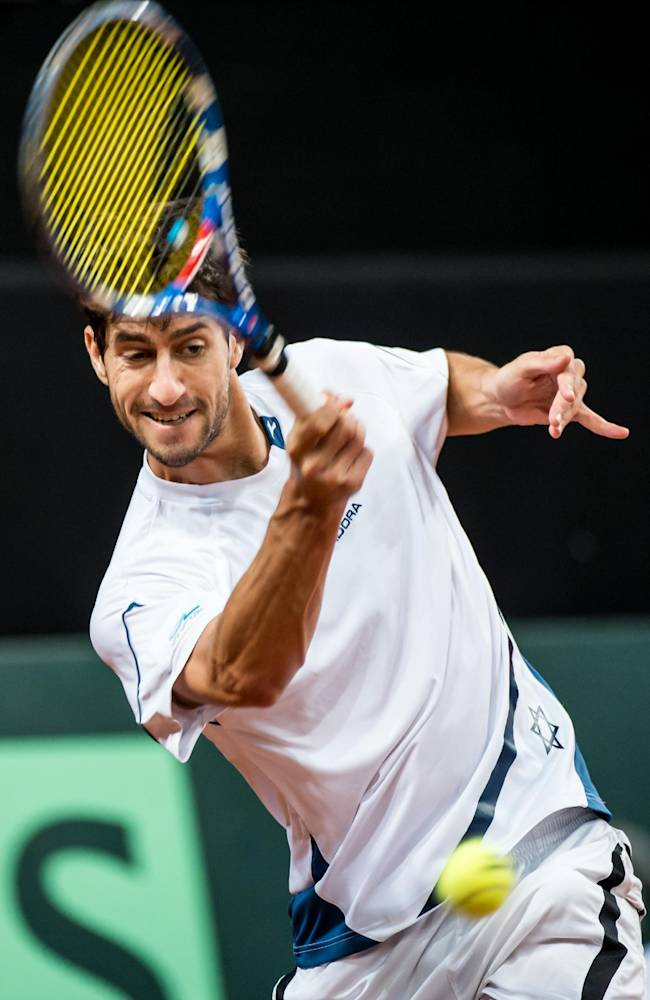 Israel's Amir Weintraub returns the ball to Belgium's Steve Darcis on the third day of the World Group play-off Davis Cup tennis in Antwerp, Belgium, on Sunday, Sept. 15, 2013