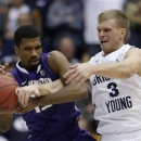 BYU's Tyler Haws, right, battles Washington's Scott Suggs for a the ball during second half action in the first round of the NIT at the Marriott Center Provo, Utah Tuesday March 19, 2013.(AP Photo/The Salt Lake Tribune, Steve Griffin)