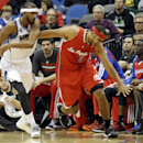 Minnesota Timberwolves' Corey Brewer, left, knocks the ball away from Los Angeles Clippers' Jared Dudley in the first quarter of an NBA basketball game, Wednesday, Nov. 20, 2013, in Minneapolis The Associated Press