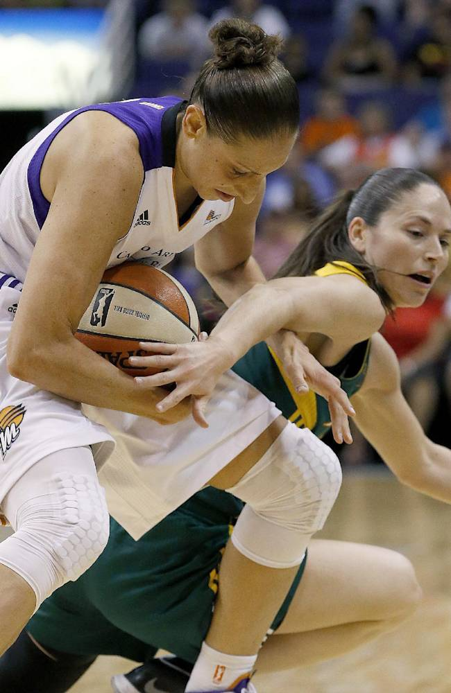 Phoenix Mercury's Diana Taurasi, left, steals the ball from Seattle Storm's Sue Bird during the first half of a WNBA basketball game on Tuesday, June 3, 2014, in Phoenix