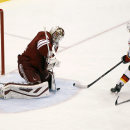 Arizona Coyotes goaltender Devan Dubnyk, left, makes a save on the shot by Calgary Flames' Johnny Gaudreau (13) as Coyotes' Keith Yandle (3) defends during the first period of an NHL game Saturday, Nov. 29, 2014 in Glendale, Ariz The Associated Press