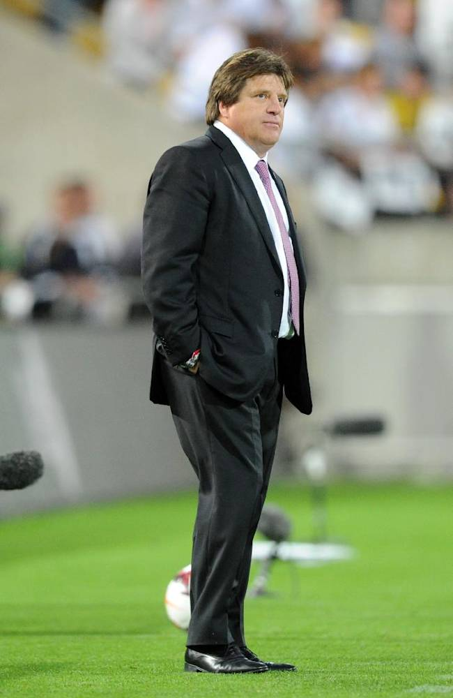 Mexico coach Miguel Herrera watches the match on the sideline in the World Cup Football qualifier against New Zealand at Westpac Stadium in Wellington, New Zealand, Wednesday, Nov. 20, 2013