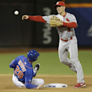 St. Louis Cardinals' Mark Ellis (3) throws to first base after forcing out New York Mets' Daniel Murphy (28) during the fourth inning of a baseball game onWednesday, April 23, 2014, in New York. Mets' Chris Young was safe at first base on the play The As