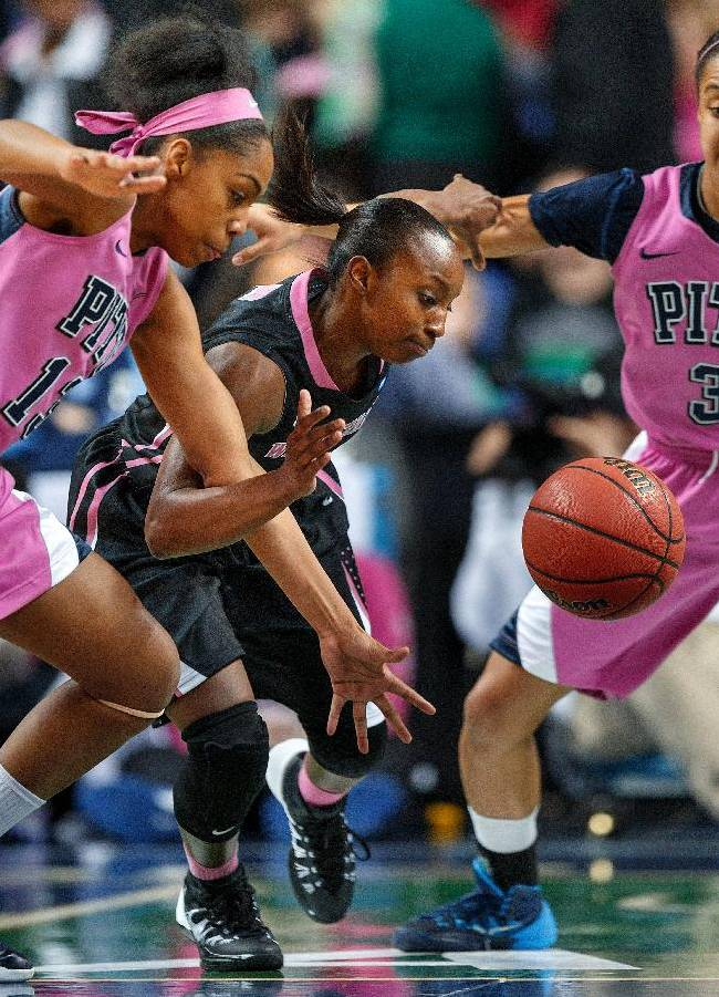 Pittsburg's Marquel Davis and Wake Forest's Chelsea Douglas battle for a loose ball during the third game of the ACC women's basketball tournament at the Greensboro Coliseum on Wednesday, March 5, 2014, in Greensboro, NC