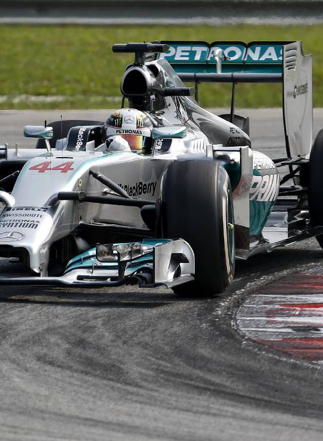Mercedes driver Lewis Hamilton of Britain steers his car during the Malaysian Formula One Grand Prix at Sepang International Circuit in Sepang, Malaysia, Sunday, March 30, 2014
