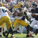 Chicago Bears quarterback Jay Cutler (6) scrambles away from Green Bay Packers defenders in the first half of an NFL football game Sunday, Sept. 28, 2014, in Chicago. The Associated Press