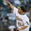 Oakland Athletics' Bartolo Colon works against the Los Angeles Angels in the first inning of a baseball game, Tuesday, Aug. 7, 2012, in Oakland, Calif. (AP Photo/Ben Margot)