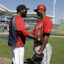 Boston Red Sox designated hitter David Ortiz, left, greets Minnesota Twins pitcher Samuel Deduno, right, before of an exhibition baseball game Friday, Feb. 28, 2014, in Fort Myers, Fla The Associated Press