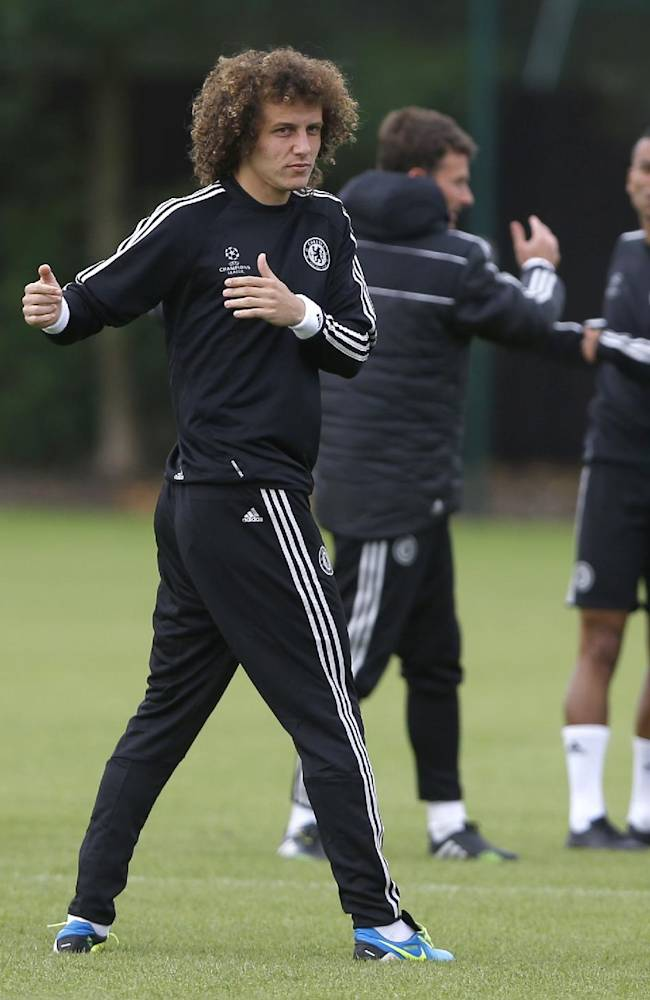 Chelsea's David Luiz stretches during a training session at their training ground in Cobham, Surrey, England, Tuesday, Sept. 17, 2013. Chelsea will play FC Basel in a Champions League match at Stamford Bridge on Wednesday