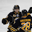 Buffalo Sabres center Tyler Ennis (63) celebrates a goal by Zemgus Girgensons (28) during the third period of an NHL hockey game against the Calgary Flames Thursday, Dec. 11, 2014, in Buffalo, N.Y. Buffalo won 4-3 The Associated Press