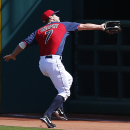 Cleveland Indians right fielder David Murphy catches a fly ball by Chicago White Sox's Dayan Viciedo during an exhibition baseball game in Goodyear, Ariz., Tuesday, March 4, 2014 The Associated Press
