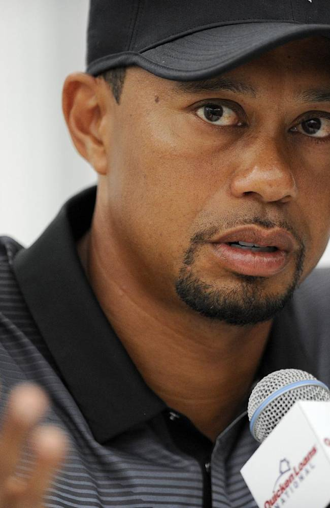 Tiger Woods speaks at a press conference at the Quicken Loans National golf tournament, Tuesday, June 24, 2014, in Bethesda, Md