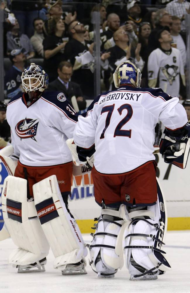 Columbus Blue Jackets goalie Sergei Bobrovsky (72) is replaced by goalie Curtis McElhinney (31) after allowing his third goal of the NHL hockey game, in the second period against the Pittsburgh Penguins in Pittsburgh on Friday, Nov. 1, 2013