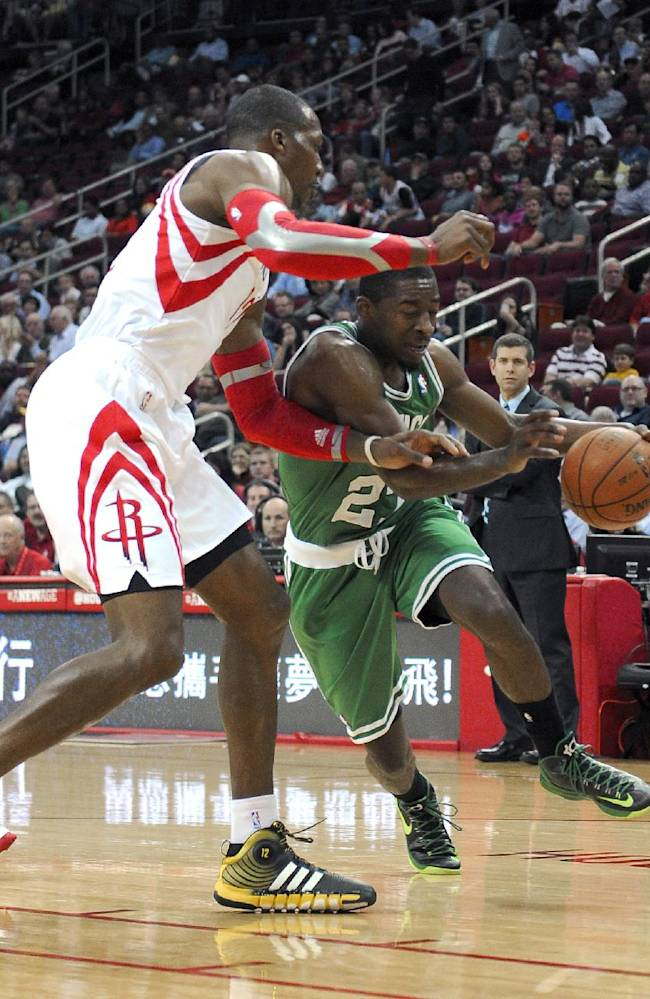 Boston Celtics' Jordan Crawford (27) drives the ball around Houston Rockets' Dwight Howard in the first half of an NBA basketball game Tuesday, Nov. 19, 2013, in Houston
