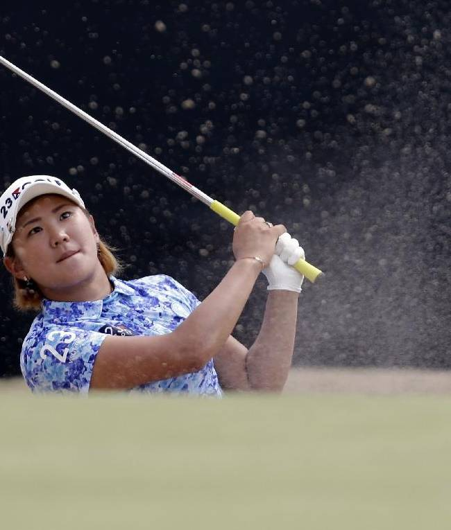 Misuzu Narita, of Japan, watches her shot from a sand trap on the 12th hole during the second round of the U.S. Women's Open golf tournament in Pinehurst, N.C., Friday, June 20, 2014