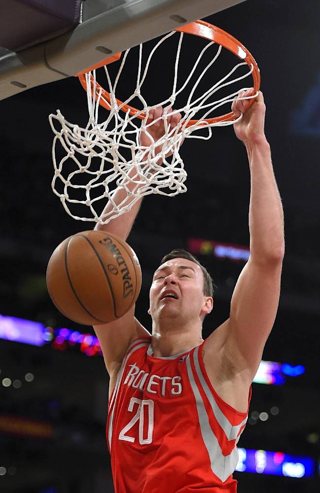 Houston Rockets forward Donatas Motiejunas dunks during the second half of an NBA basketball game against the Los Angeles Lakers, Tuesday, April 8, 2014, in Los Angeles. The Rockets won 145-130