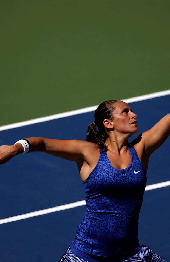 Roberta Vinci, of Italy, serves against Shuai Peng, of China, during the third round of the 2014 U.S. Open tennis tournament, Friday, Aug. 29, 2014, in New York