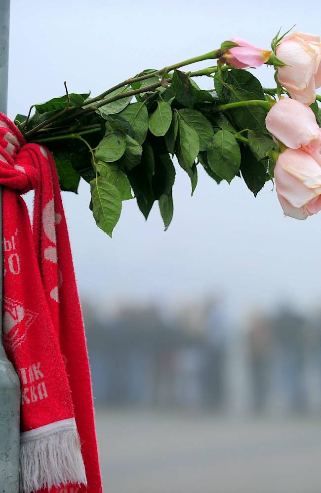 A floral tribute outside Arena 2000 Stadium where the funeral ceremony for hockey player Alexander Galimov took place. Galimov was one of the two survivors of the 7 September plane crash in which Lokomotiv Yaroslavl players and coaching staff were killed.