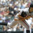 San Francisco Giants starting pitcher Barry Zito works against the Colorado Rockies in the first inning of the MLB National League baseball game in Denver on Sunday, May 19, 2013. (AP Photo/David Zalubowski)