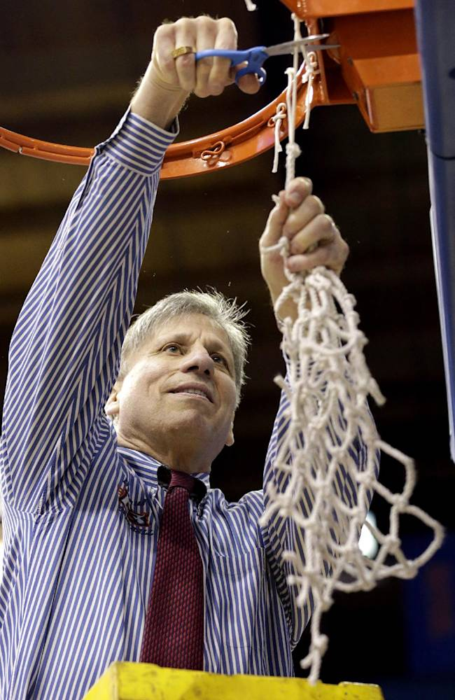 DePaul head coach Doug Bruno cuts down the net after defeating St. John's 65-57 during an NCAA college basketball game in the final of the 2014 Big East women's basketball tournament in Rosemont, Ill., Tuesday, March 11, 2014