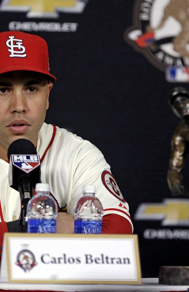 St. Louis Cardinals' Carlos Beltran speaks after he was honored as the Roberto Clemente Award winner before Game 3 of baseball's World Series between the Boston Red Sox and the St. Louis Cardinals  Saturday, Oct. 26, 2013, in St. Louis