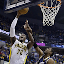 Indiana Pacers center Ian Mahinmi, left, is fouled as he shoots by Utah Jazz guard Alec Burks during the first half of an NBA basketball game in Indianapolis, Sunday, March 2, 2014 The Associated Press