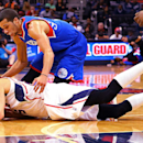 Atlanta Hawks guard Kyle Korver, returning to playing after missing six games with back spasms, dives for a loose ball against 76ers guard Michael Carter-Williams, top, during the second half of an NBA basketball game on Monday, March 31, 2014, in Atlanta