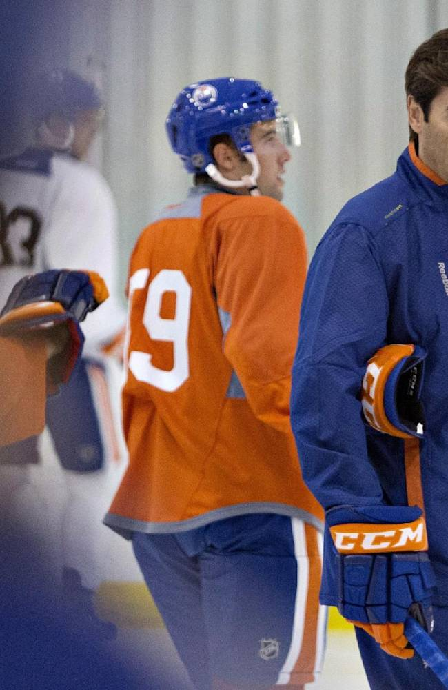 Edmonton Oilers coach Dallas Eakins directs the drills during the NHL hockey team's training camp in Sherwood Park, Alberta, on Thursday, Sept. 12, 2013